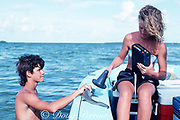high school students interning in U. Miami / Office of Naval Research joint research program scan a lemon shark, Negaprion brevirostris, to check the signal from an electronic tag, Florida Bay, Florida Keys, USA, North America