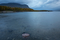 Stormy autumn weather on the western shore of lake Riebnes, Kungsleden Trail, Lapland, Sweden