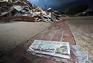 Aug, 27, Newspaper on the drive way of a home with all of its contents removed from in Denahm Springs Louisiana following a 1000 year flood that impacted numerous parishes in Southern Louisiana.