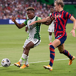Nigeria's RITA CHIKWELU (10) and TIERNA DAVIDSON (12) of the USA fight for a ball as the US Women's National Team (USWNT) beats Nigeria, 2-0 in the inaugural match of Austin's new Q2 Stadium. The U.S. women's team, an Olympic favorite, is wrapping up a series of summer matches to prep for the Tokyo Games.
