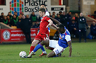 Accrington Stanley midfielder Sam Finley (14) is tackled by Ipswich Town defender Aristote Nsiala (22)  during the The FA Cup 3rd round match between Accrington Stanley and Ipswich Town at the Fraser Eagle Stadium, Accrington, England on 5 January 2019.