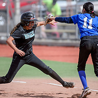 Chief Manuelito Maverick Brianna Tsosie (26) jumps back to first to avoid a pickoff from Gallup Mid School Mustang Logan Heredia (11) Wednesday at Ford Canyon Park.