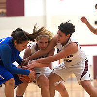 011113      Cayla Nimmo<br /> <br /> Navajo Pine Lady Warrior Gikoby Catron (22) and Ramah Mustangs Charlie Daniels (14) and Baylie Daniels (30) fight for possession of the ball during the Tuesday night game at Ramah High School.