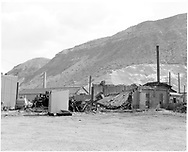 """D&RGW Durango roundhouse in the process of being rebuilt on the west end.  7 bays remain in rebuilt roundhouse. [there was not a fire, just remodeling to downsize the roundhouse, although this photo looks like total destruction. WRP - see page 44 in """"Durango"""" book.]<br /> D&RGW  Durango, CO  Taken by Payne, Andy M. - 5/15/1971<br /> In book """"Durango: Always a Railroad Town (1st ed.)"""" page 47<br /> The roundhouse did burn onFebruary 10, 1989."""