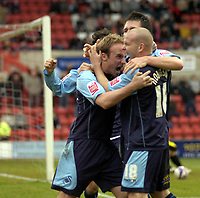 Photo: Matt Bright/Sportsbeat Images.<br /> Swindon Town v Swansea City. Coca Cola League 1. 01/01/2008.<br /> Thomas Butler (l) celebrates scoring for Swansea with Andy Robinson (r)
