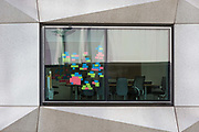 Post-it notes stuck to the window of a meeting room in an office on London Wall in the City of London - the capitals financial district, on 21st August 2018, in London, England.