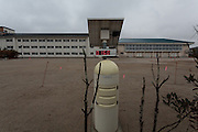 An abandoned school building with a radiation meter in the playground inside the Fukushima exclusion zone, Namie, Fukushima, Japan. Wednesday March 9th 2016. The Great East Japan Earthquake on March 11th 2011 was followed by a massive tsunami that levelled much of the Tohoku coast in north east Japan, killing around 18,000 people and causing meltdowns and explosions at the Fukushima Daiichi nuclear power station leading to the contamination and evacuation of a 20 kilometre exclusion zone around the plant.