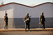 Mexican Army Soldiers patrol along a main road in Juarez, Mexico January 16, 2009. The army stepped in to stop an ongoing drug war which resulted in more than 1600 people killed in Juarez in 2008, making Juarez the most violent city in Mexico. The situation has failed to improve with more than 40 people since the start of the year.     (Photo by Richard Ellis)