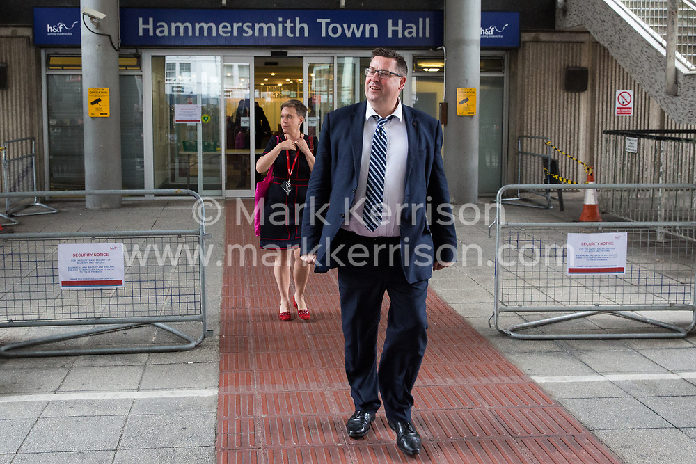 London, UK. 17 July, 2019. Cllr Stephen Cowan, Leader of the London Borough of Hammersmith and Fulham, arrives to declare a climate emergency before climate activists from Extinction Rebellion assembled outside Hammersmith Town Hall following a Critical Mass bicycle ride from Waterloo Millennium Green on the third day of their 'Summer uprising'. The activists have three demands for Hammersmith and Fulham Council: to pass the proposed motion to declare a Climate Emergency; to keep Hammersmith bridge closed to vehicles; and to commit to safer cycling routes.
