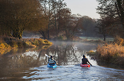 © Licensed to London News Pictures. 02/01/2017. Godalming, UK. Canoeists navigate the River Wey near Godalming at first light. A cold spell is expected to remain for most of the next week. Photo credit: Peter Macdiarmid/LNP
