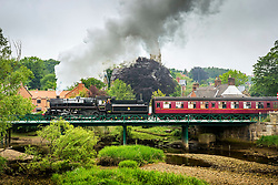 """© Licensed to London News Pictures. 28/05/2018. Ruswarp UK. Locomotive 76079 BR Standard known as the """"pocket rocket"""" crosses the river Esk in the picturesque village of Ruswarp in the Yorkshire moors today on route from Whitby to Pickering. Photo credit: Andrew McCaren/LNP"""