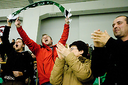 Fans of Olimpija celebrate after Olimpija scored second time at 6th Round of ice-hockey Slovenian National Championships match between HDD Tilia Olimpija and HK Acroni Jesenice, on April 2, 2010, Hala Tivoli, Ljubljana, Slovenia.  Acroni Jesenice won 3:2 after overtime and became Slovenian National Champion 2010. (Photo by Vid Ponikvar / Sportida)