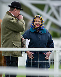 © London News Pictures. 08/05/2013. Windsor, UK. HRH Queen Elizabeth II watching her horse 'First Love' compete in the Thoroughbread Ridden Show Horse Class on day one of the Royal Windsor Horse Show, set in the grounds of Windsor Castle. Established in 1943, this year will see the Show celebrate its 70th anniversary. Photo credit: Ben Cawthra/LNP