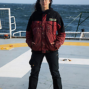 """Marlene, 23, volunteer. Currently on leave from her studies in Psycology, sociology and philisophy.  """" When I am at sea I dont miss the world. All is calm."""" On the heli deck, photographed at sea on patrol in the North Sea."""
