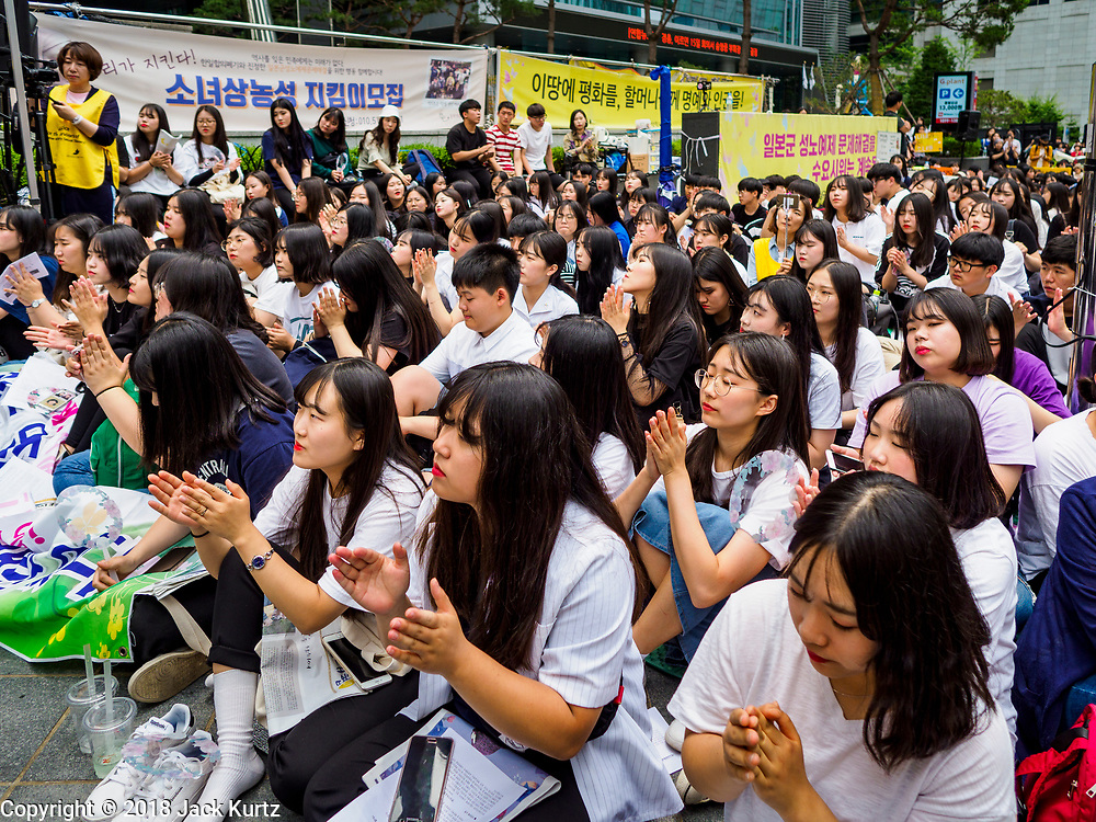 """SEOUL, SOUTH KOREA: South Korean women applaud for a speaker during the Wednesday protest at the Japanese embassy in Seoul. The Wednesday protests have been taking place since January 1992. Protesters want the Japanese government to apologize for the forced sexual enslavement of up to 400,000 Asian women during World War II. The women, euphemistically called """"Comfort Women"""" were drawn from territories Japan conquered during the war and many came from Korea, which was a Japanese colony in the years before and during the war. The """"comfort women"""" issue is still a source of anger of many people in northeast Asian areas like South Korea, Manchuria and some parts of China.     PHOTO BY JACK KURTZ   <br /> Wednesday Demonstration demanding Japan to redress the Comfort Women problems"""