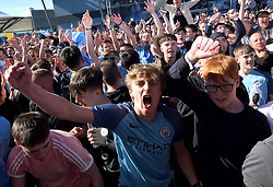 Manchester City fans celebrate as Manchester City win the premier league, at the Etihad Stadium, Manchester.