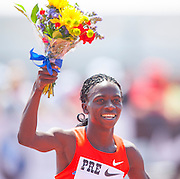 FRANCINE NIYONSABA (BDI) waves a boquet as she celebrates her win in the Womens 800m competition during the second day of the Diamond League event Prefontaine Classic held at the University of Oregons Hayward Field.The Prefontaine Classic is named for University of Oregon track legend Steve Prefontaine. Kynard finished second in the event.