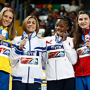 Gold medal winner Chaunte Lowe from the United States, 2nd right, is flanked by silver medal winners Anna Chicherova from Russia, right, and Antonietta Di Martino from Italy and Ebba Jungmark from Sweden, left, during the ceremony for the Women's High Jump during the IAAF World Indoor Championships at the Atakoy Athletics Arena, Istanbul, Turkey. Photo by TURKPIX