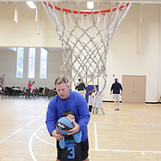 Pastor Donnie King Jr. helps Landon Blacher shoot free-throws before a Halo Basketball game Saturday December 20, 2014 at Grace United Methodist Church in Wilmington, N.C. (Jason A. Frizzelle)