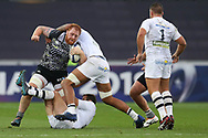 Dan Baker of the Ospreys (l) is tackled. European Rugby Champions Cup, pool 2 match, Ospreys v ASM Clermont Auvergne at the Liberty Stadium in Swansea, South Wales on Sunday 15th October 2017.<br /> pic by  Andrew Orchard, Andrew Orchard sports photography.