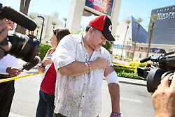 Mass shooting survivor George Sanchez, of San Diego, shows where he was shot Sunday night and meets with the news media on the Las Vegas Strip Tuesday, Oct. 3, 2017, in Las Vegas. His girlfriend Johanna Ernst stands nearby. A mass shooting occurred late Sunday evening at the Route 91 Harvest country music festival. (Photo by Ronda Churchill/ZUMA Press)