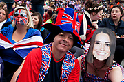 Revellers gather in Trafalgar Square in Central London to celebrate the Royal Wedding of Prince William and Kate Middleton on 29th April 2011. The crowds gathered from early in the morinng to watch the ceremony on the big screen and to show their support and patriotism for the Royal couple.