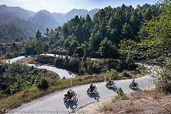 Riding , (front > Back), Biltwell photographer Geoff Kowalchuk, Biltwell's mechanic and special projects guy Rob Galan of Rouserworks, Biltwell's Patrick Lies and tattoo artist Justin Big Meas Wilson ride the twisties on Motorcycle Sherpa's Ride to the Heavens motorcycle adventure in the Himalayas of Nepal. Riding from Daman back to Kathmandu. Wednesday, November 13, 2019. Photography ©2019 Michael Lichter.