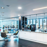 A panoramic interior photography showing a Regus workspace aimed at shared co working business people.