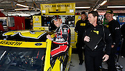 NASCAR Sprint Cup Series auto racing driver Matt Kenseth, left, reacts to his garage crew as gets in his car before a morning practice run at Kansas Speedway in Kansas City, Kan., Saturday, Oct. 17, 2015. (AP Photo/Colin E. Braley)