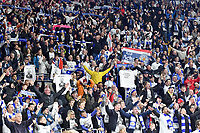 Football - 2018 / 2019 Premier League - Cardiff City vs. Leicester City<br /> <br /> Leicester fans salute their team after the game in Leicster's 1st match since the death of Vichai Srivaddhanaprabha, at Cardiff City Stadium.<br /> <br /> COLORSPORT/WINSTON BYNORTH