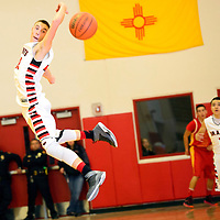 112613  Adron Gardner/Independent<br /> <br /> Grants Pirate XXX (32) leaps to pick off an Española Valley Sundevil pass in Grants Tuesday.