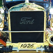 A Ford Model T built in 1926 that has been restored beyond  its original condition.