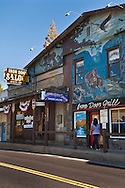 Exterior wall mural on The Iron Door Saloon in Groveland, the oldest continuously operating tavern bar in California
