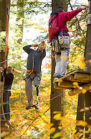 Dana Osborne, David Santamore and guide Kevin Vorachith maneuver through Gunstock's Aerial Treetop Adventure Course with the Wounded Warrior group on Monday afternoon.  (Karen Bobotas/for the Laconia Daily Sun)