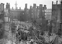 Interior shot of the ruins of the Metropole Hotel at the junction of Sackville (O'Connell) St and Princes St. The GPO is visible to the left and Nelsons Pillar is visible in the background.<br /> (Part of the Independent Newspapers Ireland/NLI Collection)
