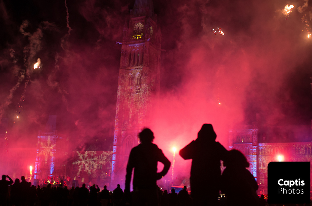 People watch a fireworks display during the opening ceremony for Parliament Hill's holiday lights. December 3, 2014.