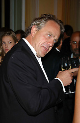Writer HENRY PORTER at a party hosted by Dom Perignon and Vanity Fair magazine to celebrate the launch of a unique collection of essays based on the theme of seduction to raise money for the charity English Pen. The paty was held at the Dom Perignon Mallroom,  13 Grosvenor Crescent, London W1 on 8th September 2004.