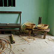 Interior of a home in Phu Vinh, rattan and bamboo basket weaving village, Ha Tay province, Vietnam. With Vietnam's growing population making less land available for farmers to work, families unable to sustain themselves are turning to the creation of various products in rural areas.  These 'craft' villages specialise in a single product or activity, anything from palm leaf hats to incense sticks, or from noodle making to snake-catching. Some of these 'craft' villages date back hundreds of years, whilst others are a more recent response to enable rural farmers to earn much needed extra income.
