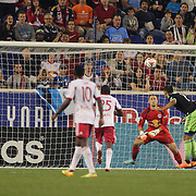 Clint Dempsey, Seattle Sounders, has a close range header sopped by goalkeeper Luis Robles, during the New York Red Bulls Vs Seattle Sounders, Major League Soccer regular season match at Red Bull Arena, Harrison, New Jersey. USA. 20th September 2014. Photo Tim Clayton