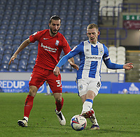 Huddersfield Town's Lewis O'Brien in action with  Birmingham City's Ivan Sunjic<br /> <br /> Photographer Mick Walker/CameraSport<br /> <br /> The EFL Sky Bet Championship - Huddersfield Town v Birmingham City - Tuesday 2nd March 2021 - The John Smith's Stadium - Huddersfield<br /> <br /> World Copyright © 2020 CameraSport. All rights reserved. 43 Linden Ave. Countesthorpe. Leicester. England. LE8 5PG - Tel: +44 (0) 116 277 4147 - admin@camerasport.com - www.camerasport.com