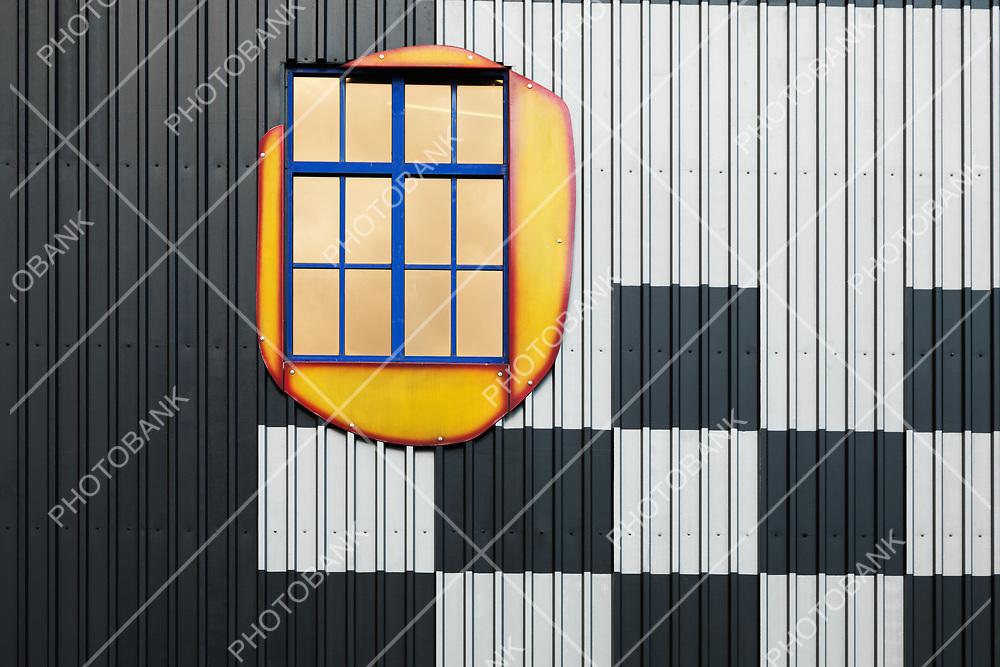 Artistic window in strange white and black building