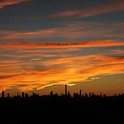 2016 U.S. Open - Day 14  The Manhattan New York City skyline at sunset showing the Empire State Building and the Chrysler building shot from the Arthur Ashe Tennis Stadium at the USTA Billie Jean King National Tennis Center on September 11, 2016 in Flushing, Queens, New York City.  (Photo by Tim Clayton/Corbis via Getty Images)