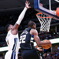 01 April 2018: Milwaukee Bucks forward Khris Middleton (22) goes for the reverse layup past Denver Nuggets forward Paul Millsap (4) during the Denver Nuggets 128-125 victory over the Milwaukee Bucks, at the Pepsi Center, Denver, Colorado, USA.