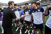 NANJING, CHINA - JUNE 18: (CHINA OUT) <br /> <br /> David Beckham Visits Jiangsu Sainty Football Club<br /> <br /> David Beckham shakes hands with Jiangsu Sainty player Deng Zhuoxiang (R) during his meeting with Jiangsu Sainty players at Nanjing Olympic Sports Centre on June 18, 2013 in Nanjing, Jiangsu Province of China.<br /> ©Exclusivepix