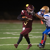 Tyrell Bitsie carries the ball for Tohatchi while Zuni's Elijah Shebola and Archie Hattie defend Friday night at Tohatchi High School.