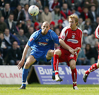 Photo: Chris Ratcliffe.<br />Leyton Orient v Grimsby Town. Coca Cola League 2. 17/04/2006.<br />Paul Connor (L) of Leyton Orient nicks the ball away from Rob Jones of Grimsby