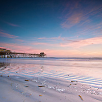 Another view of the Cocoa Beach Pier at sunrise.
