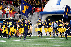 The Michigan Wolverines run out agains the Florida Gators during the Chick-fil-A Peach Bowl, Saturday, December 29, 2018, in Atlanta. ( Paul Abell via Abell Images for Chick-fil-A Peach Bowl)