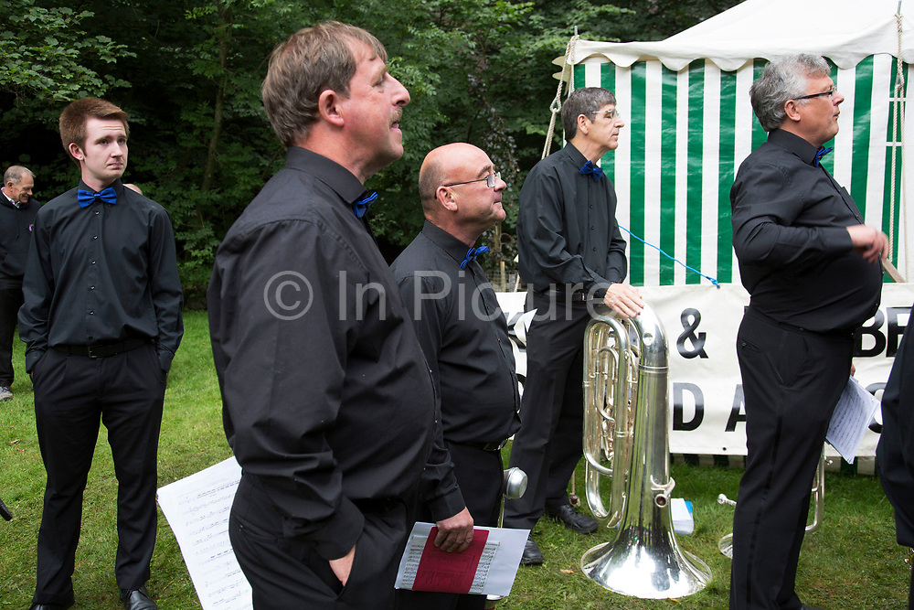 The Hardraw Scaur Brass Band Festival. Shirland Welfare band prepare for their performance. Organised by the Yorkshire and Humberside Brass Band Association, the competition is Britain's second oldest outdoor contest and takes place annually in Hardraw Scar in Wensleydale, North Yorkshire, England, UK. The area, a natural amphitheatre, attracts bands from all over the North of England and is a popular event amongst players and audiences alike.