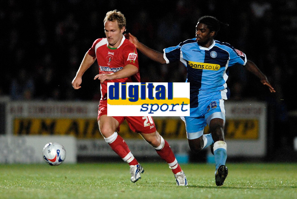 Photo: Richard Lane.<br />Wycombe Wanderers v Swindon Town. Coca Cola League 2. 26/09/2006. <br />Swindon's Royce Brownie is challenged by Wycombe's Anthony Grant.